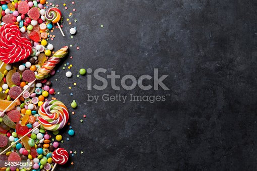 istock Colorful candies, jelly and marmalade over stone 543345518