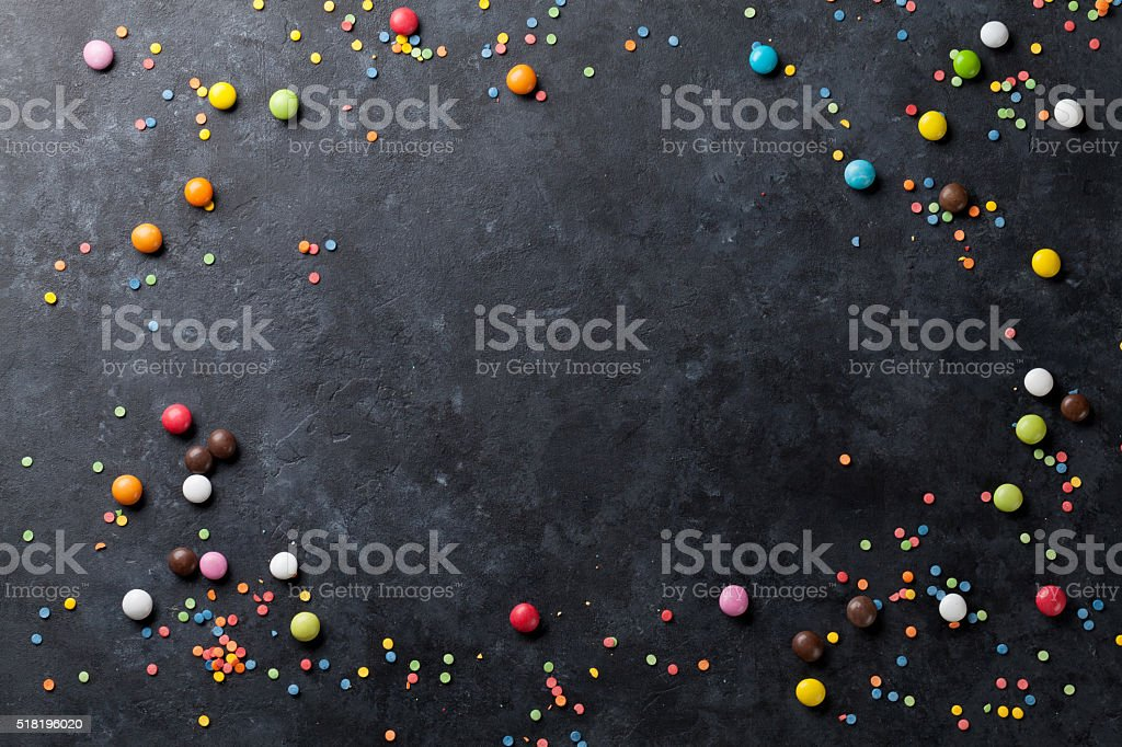 Colorful candies on stone background stock photo