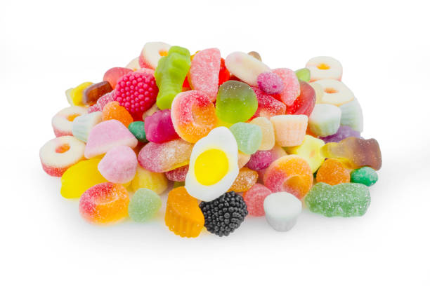 Colorful candies on white background Colorful candies on white background jujube candy stock pictures, royalty-free photos & images