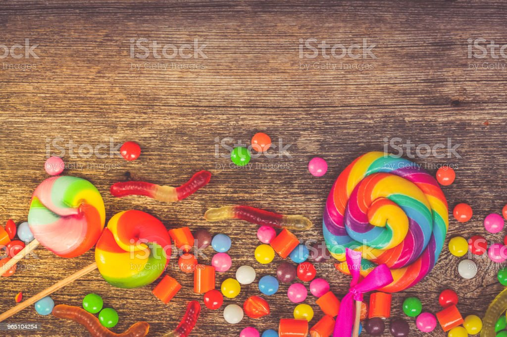 Colorful candies on wood royalty-free stock photo