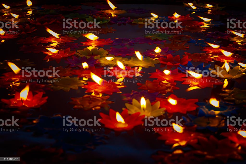 Colorful Candle floating on water for pray buddha stock photo