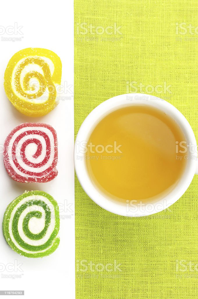 Colorful candy and tea royalty-free stock photo