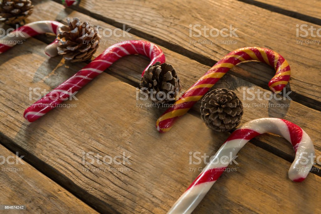 Colorful candy canes with pine cones stock photo