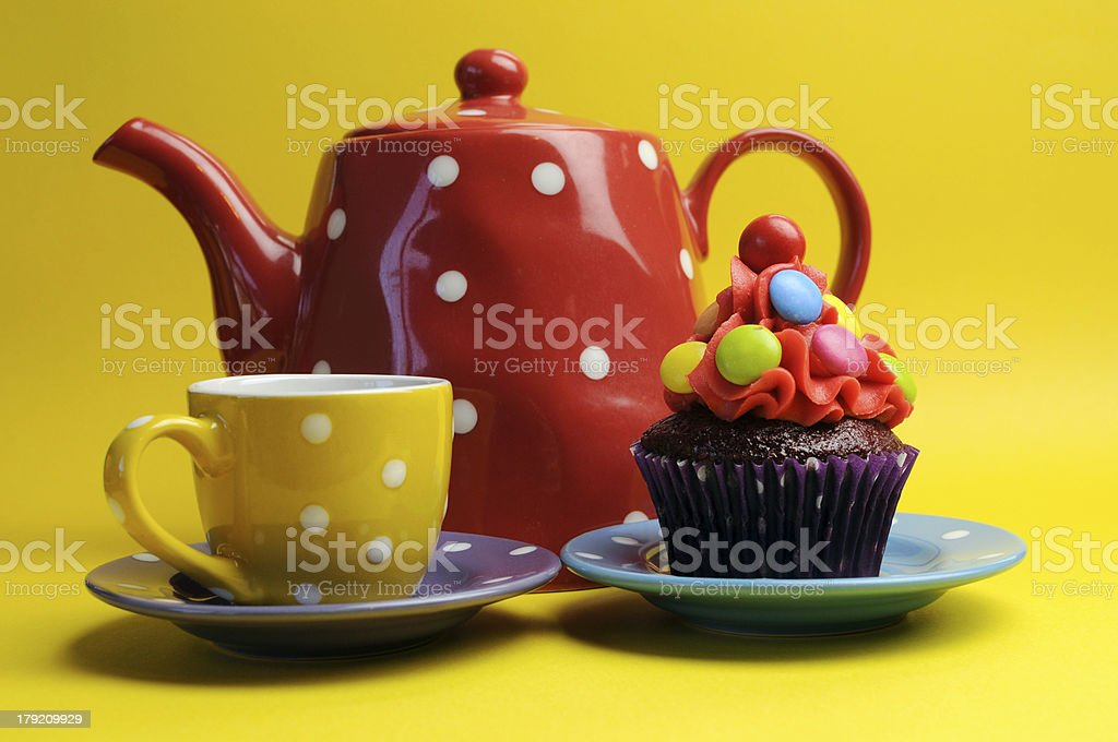 Colorful candy cupcake with polka dot tea pot and cup. royalty-free stock photo