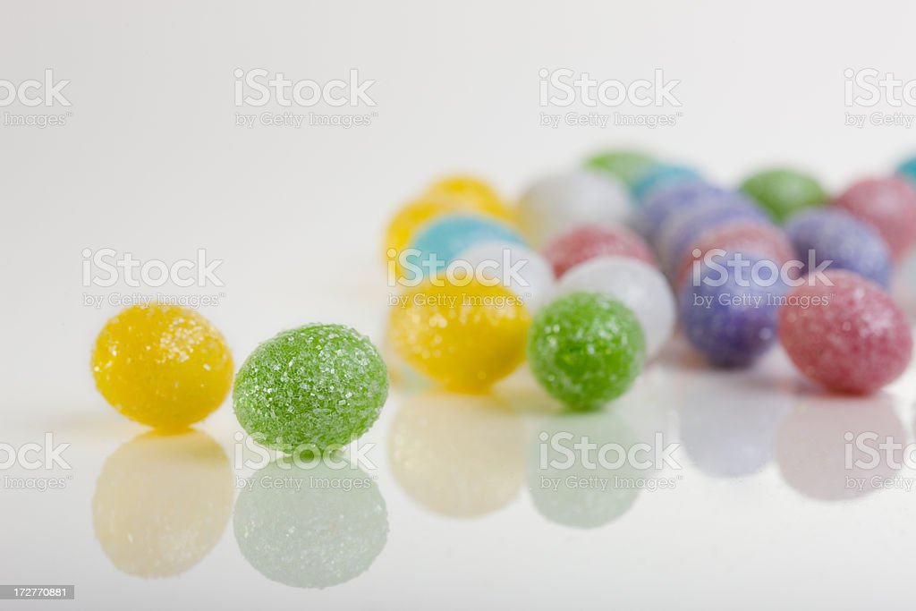 Colorful Candy Easter Egg Group on White, Copy Space stock photo