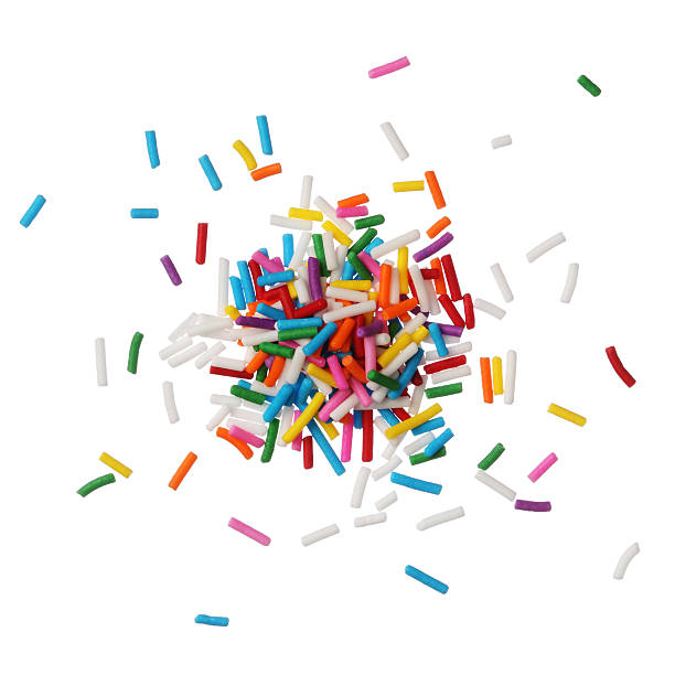 Colorful candy sprinkles isolated on white background stock photo