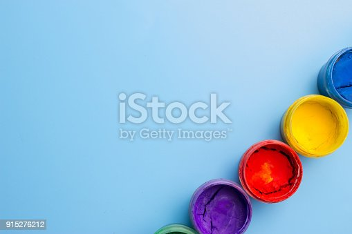 istock colorful cans with paint 915276212