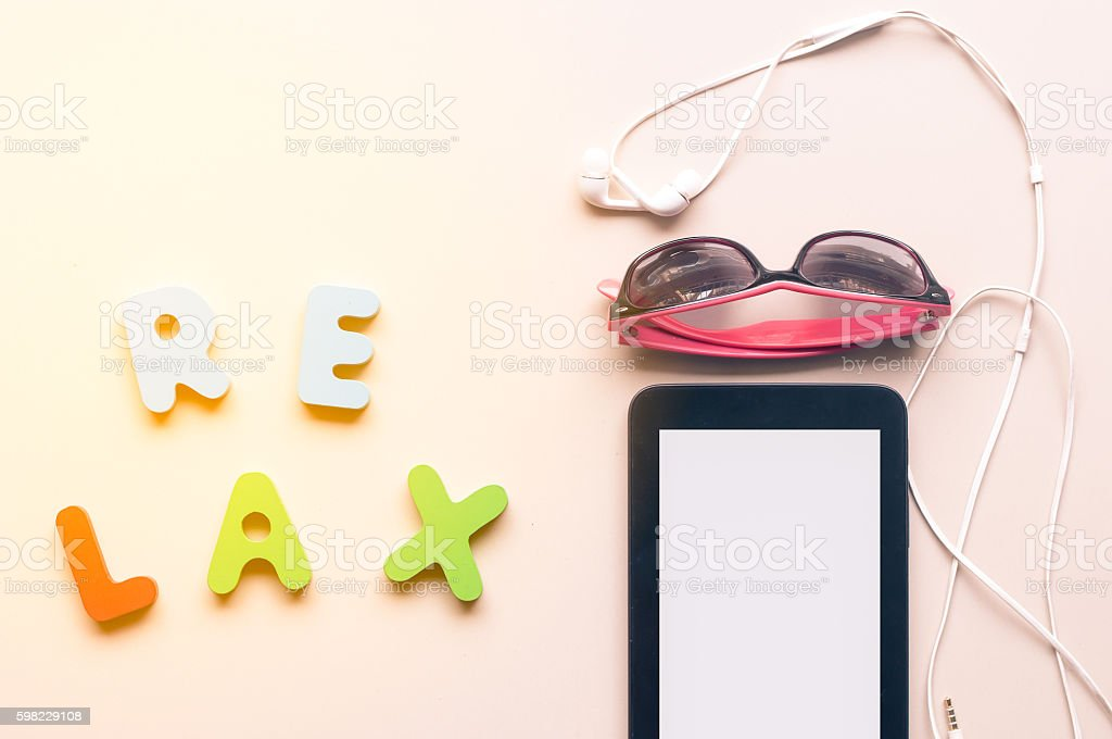colorful canvas shoe and sunglasses with RELAX alphabet foto royalty-free