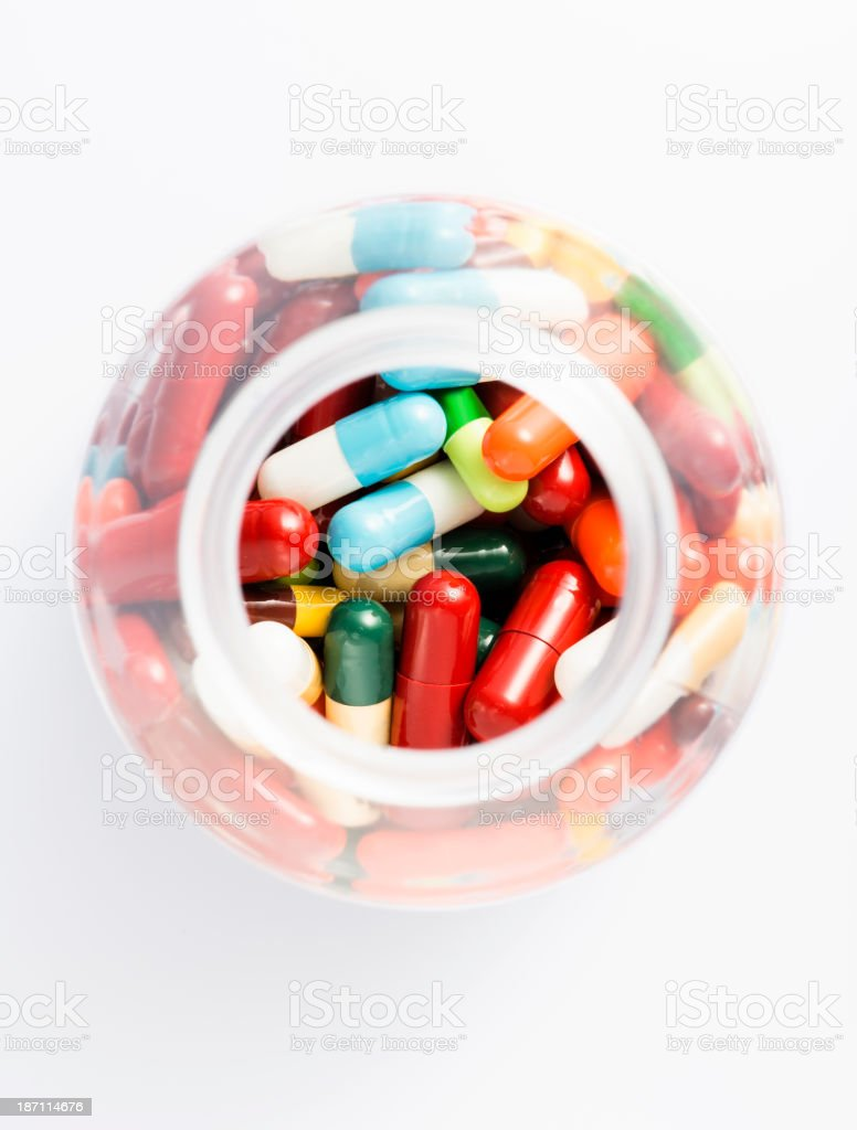 Colorful capsule pills in bottle royalty-free stock photo