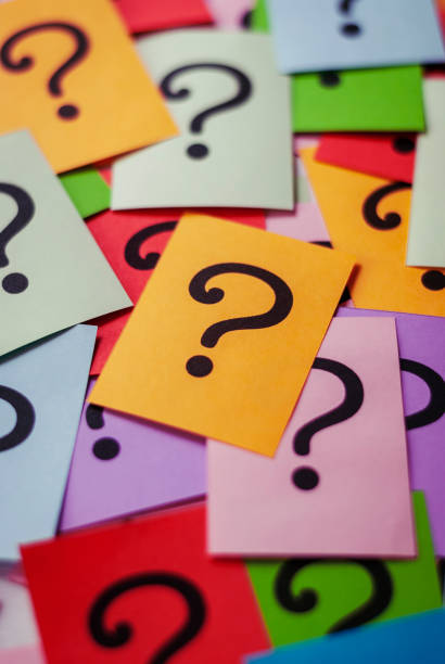 Colorful cards with printed question marks stock photo