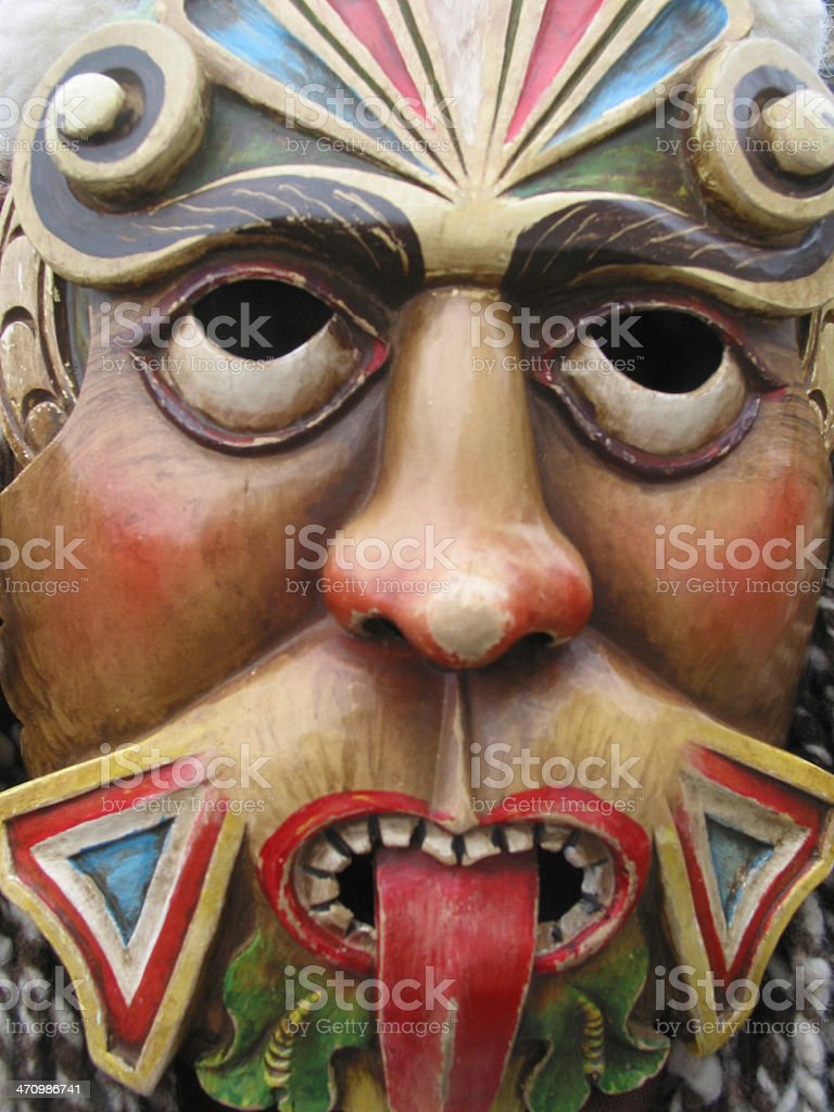 Colorful Carnival mask close up with sticking out tongue royalty-free stock photo
