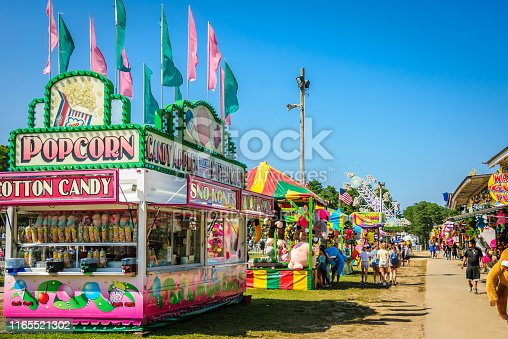 Falmouth, Massachusetts, USA-July 26, 2019-   Food trucks, games of chance and carnival  rides attract people of all ages to  the Barnstable County Fair held each summer at the fairgrounds in Falmouth, Massachusetts.