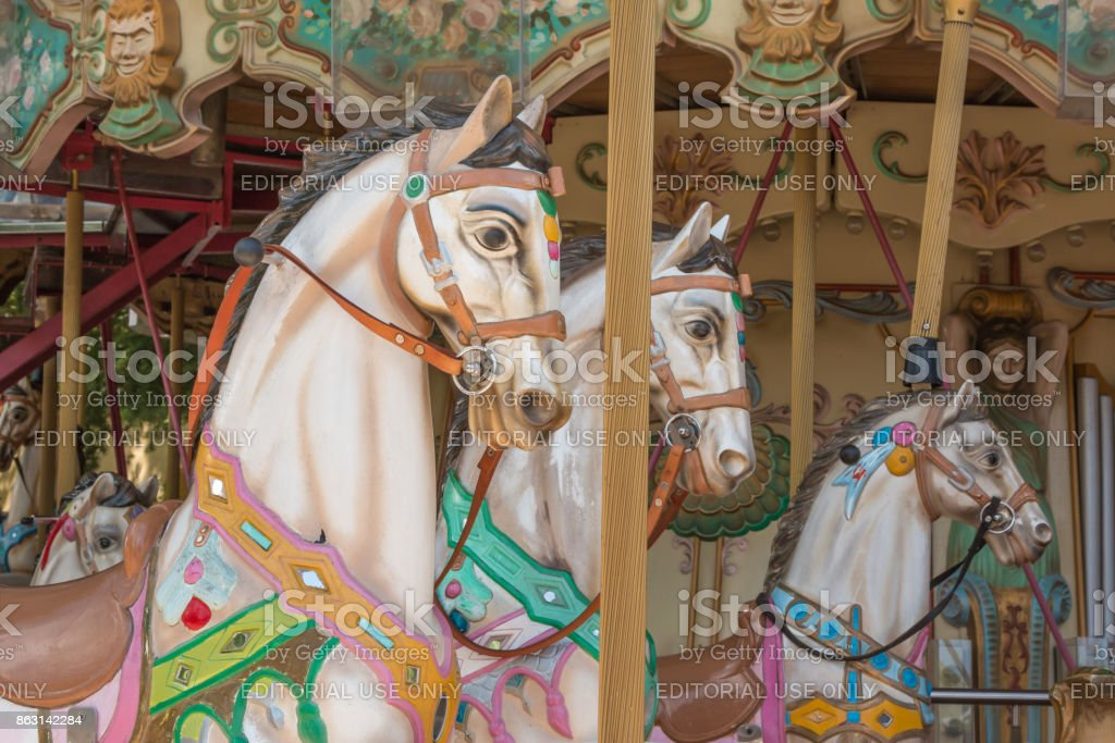 Colorful Carousel Horses In A Holiday Park Merrygoround Horse Stock Photo Download Image Now Istock