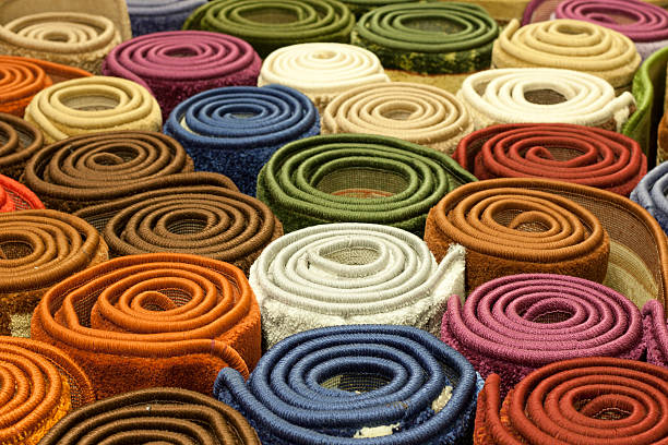 Colorful carpets in the store stock photo