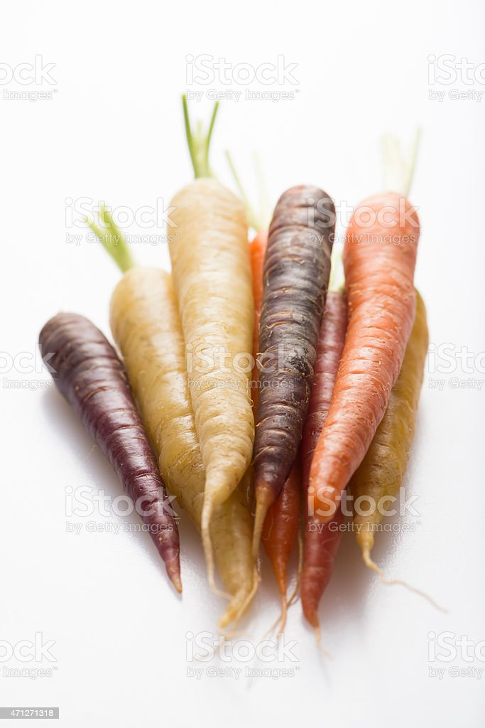 colorful carrots on white background stock photo