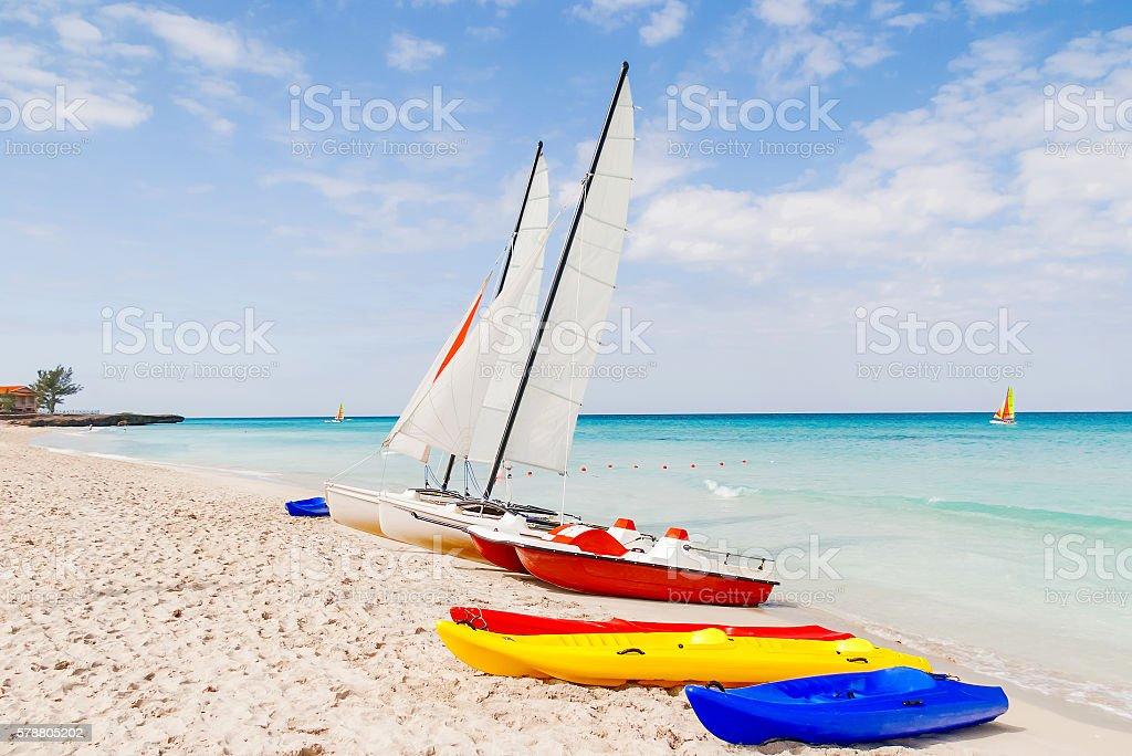 Colorful catamarans on sandy Varadero beach. Bright sunny day, Cuba. royalty-free stock photo