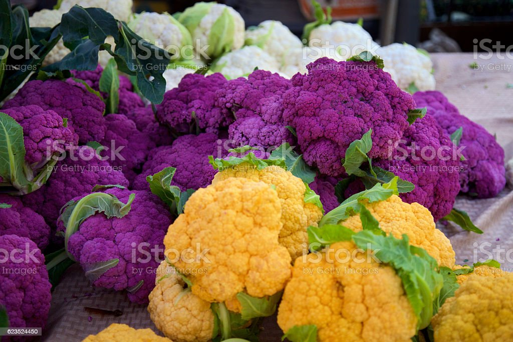 colorful cauliflower orange and purple and white cauliflower at the farmer's market Agricultural Fair Stock Photo