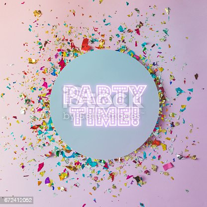 istock Colorful celebration background with party confetti on pink background. Flat lay. 672412052
