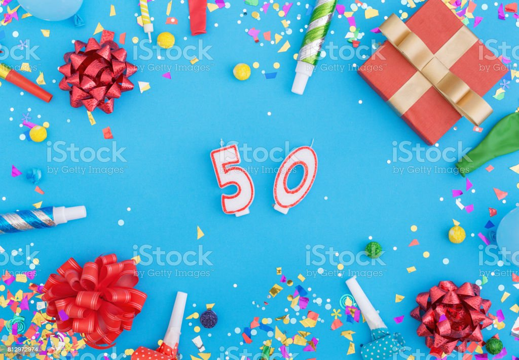 Colorful celebration pattern with various party confetti, balloons, gift box and number 50 on blue background stock photo