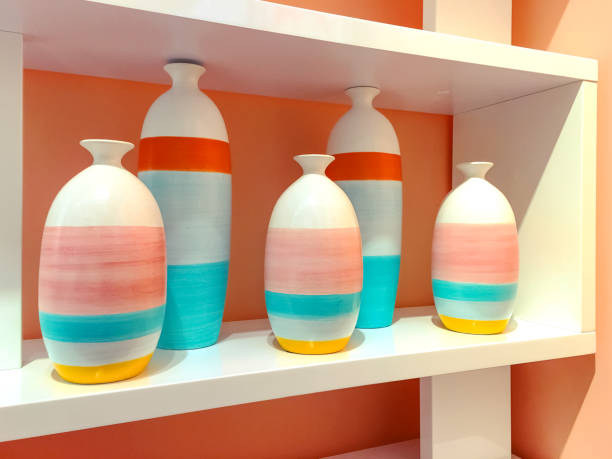 Colorful ceramic vases on a shelf stock photo