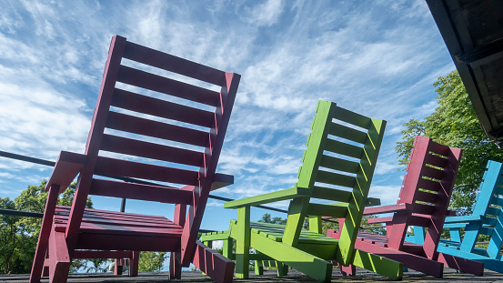 The colorful chair wit very nice blue sky wit cloud