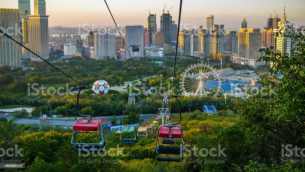 Colorful chairlifts and cityscape of Dalian, China stock photo