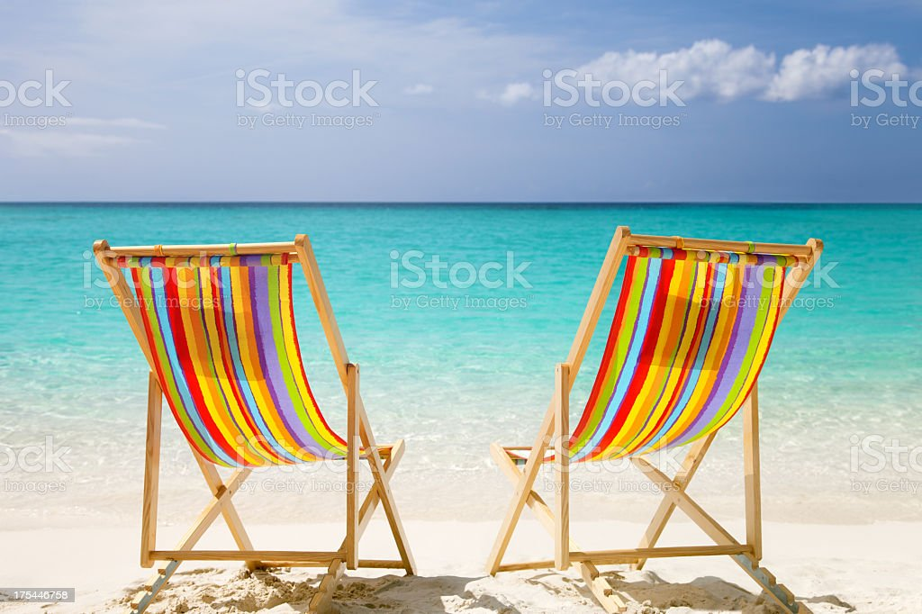 colorful chairs at a topical Caribbean beach stock photo