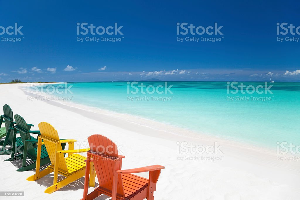 colorful chairs at a tropical beach in the Caribbean stock photo