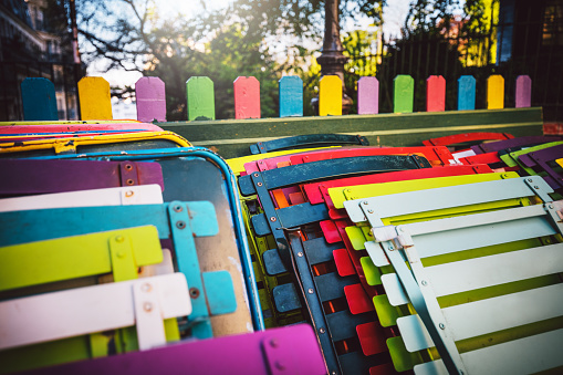 colorful chairs of Parisian outdoor cafe on Montmartre