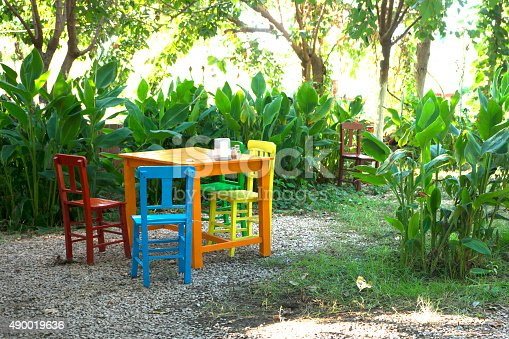 914465180istockphoto Colorful chairs 490019636