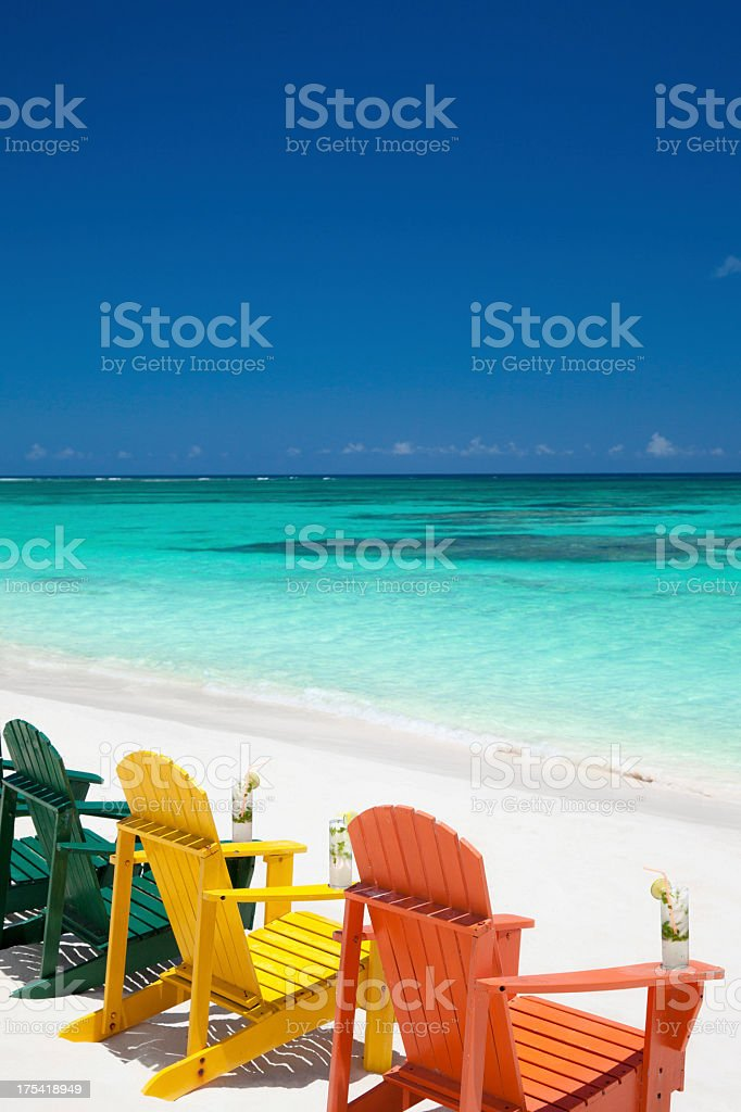 colorful chairs with drinks at a tropical Caribbean beach stock photo