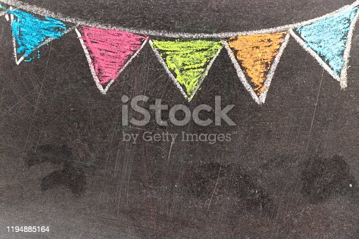 882318110 istock photo Colorful chalk drawing in hanging party flag shape on blackboard background 1194885164