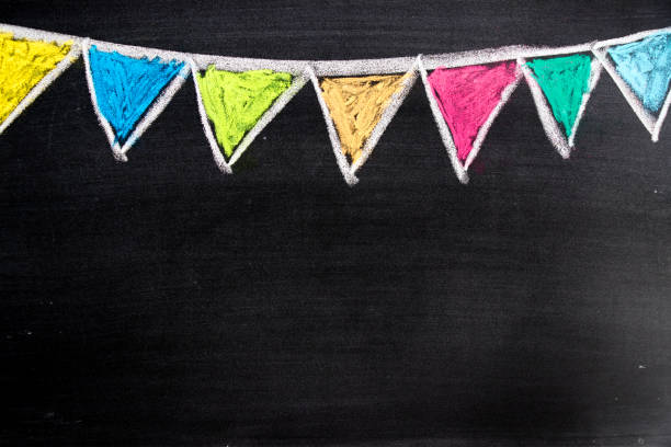 Colorful chalk drawing in hanging party flag shape on blackboard background stock photo