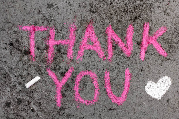 Colorful chalk drawing on asphalt: Pink words THANK YOU and small heart Colorful chalk drawing on asphalt: Pink words THANK YOU and small heart chalk art equipment stock pictures, royalty-free photos & images