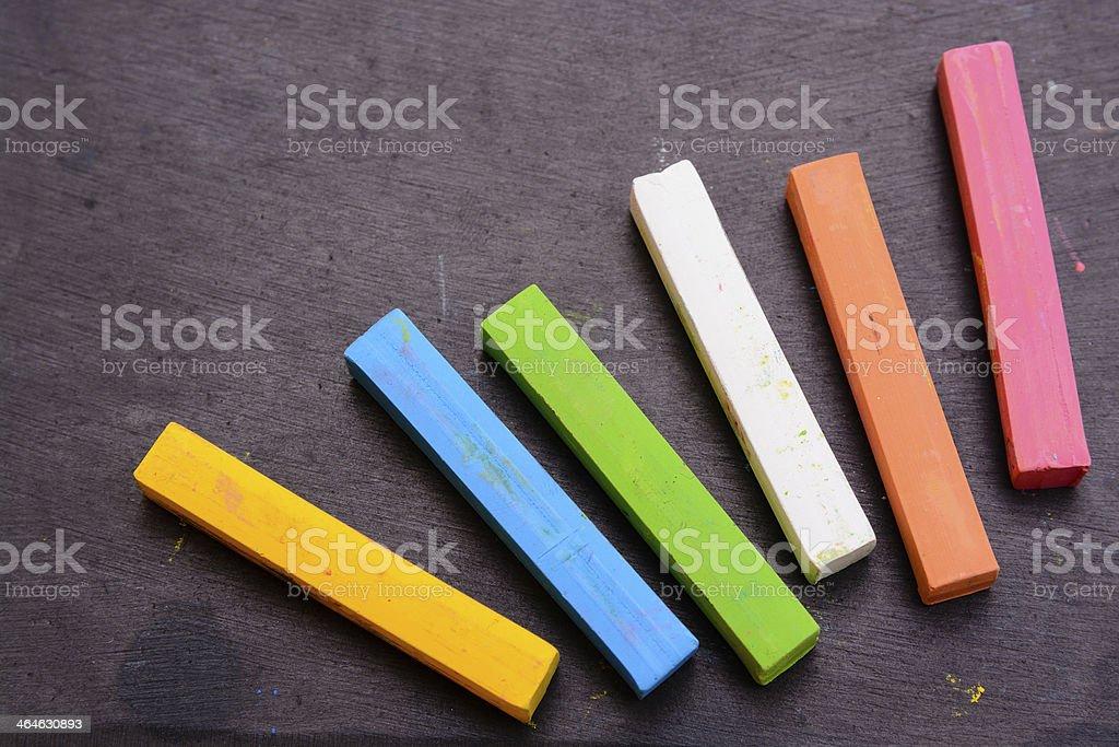 Colorful chalk on blackboard stock photo
