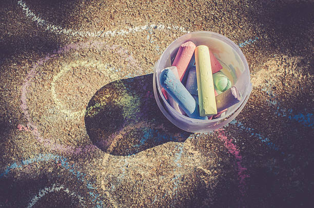 Colorful chalk on the street floor stock photo