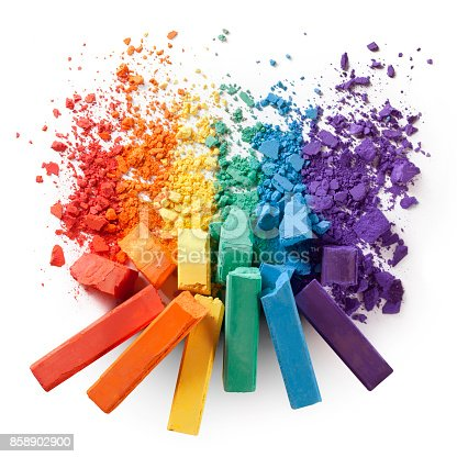 istock Colorful chalks with broken pastel particles 858902900