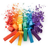 Colorful chalks with broken pastel particles
