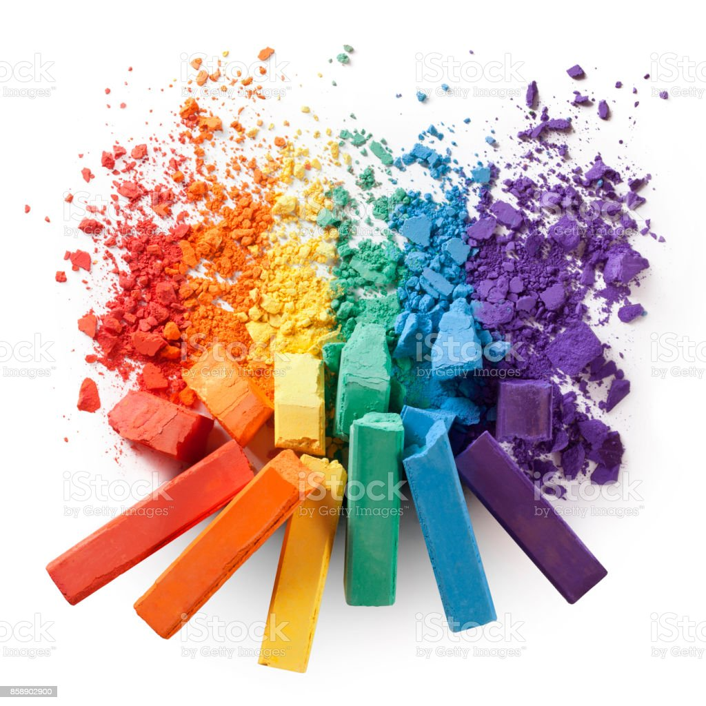 Colorful chalks with broken pastel particles stock photo