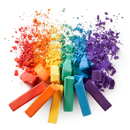 Colorful Chalks With Broken Pastel Particles Stock Photo - Download Image Now