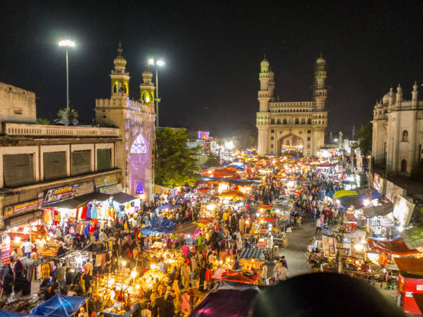 Colorful chaos in the Streets of Charminar LG-H990 char minar stock pictures, royalty-free photos & images