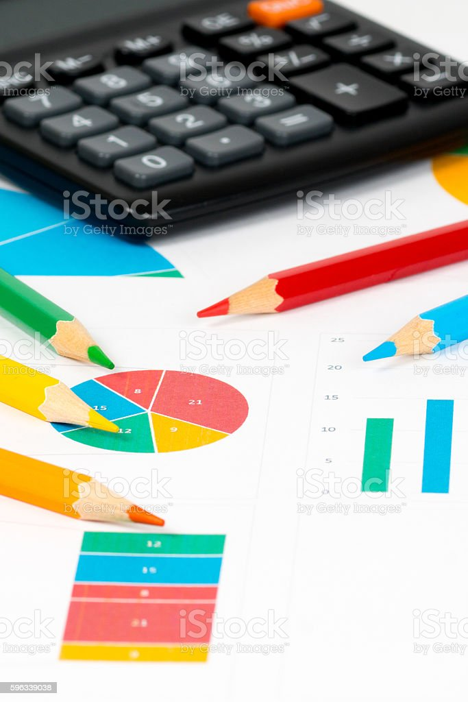 colorful charts with pencils and calculator royalty-free stock photo