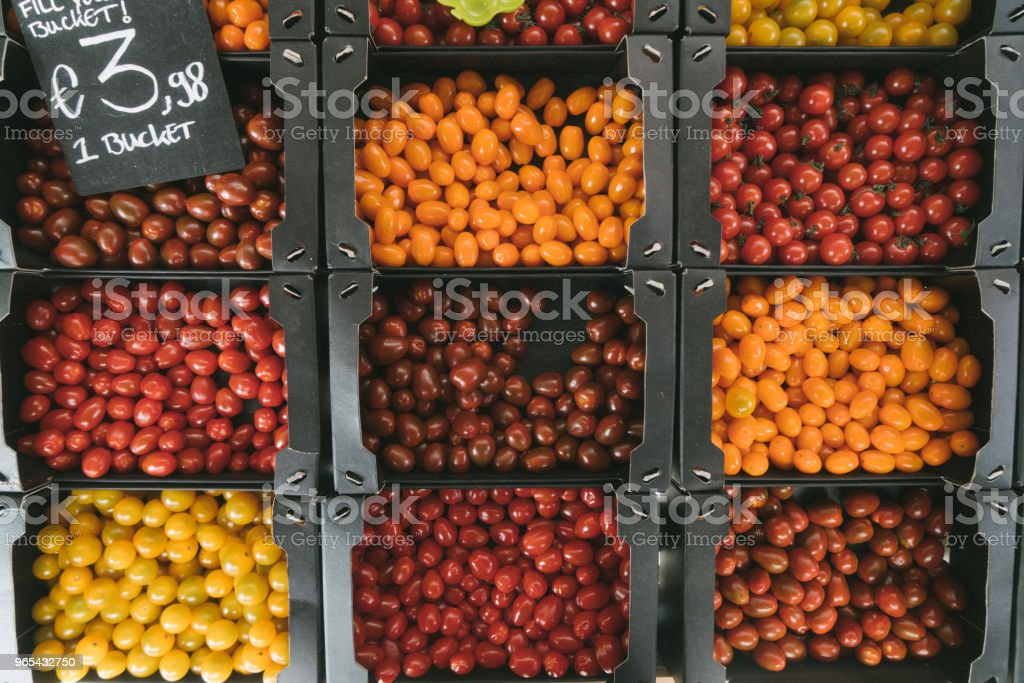 Colorful cherry tomatoes in box zbiór zdjęć royalty-free