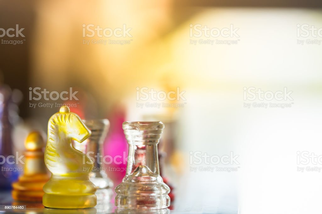 Colorful chess pieces on board, business strategy stock photo
