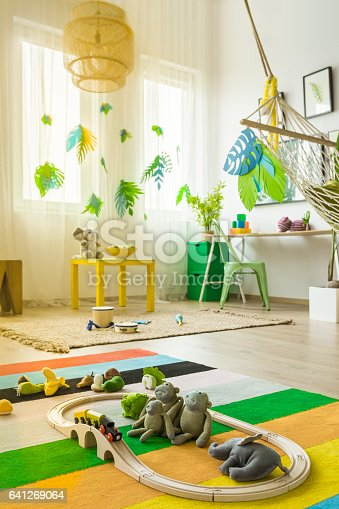 istock Colorful child room with rug 641269064