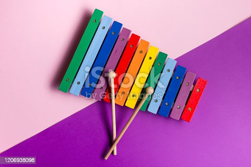 Colorful child wooden xylophone isolated on white background.