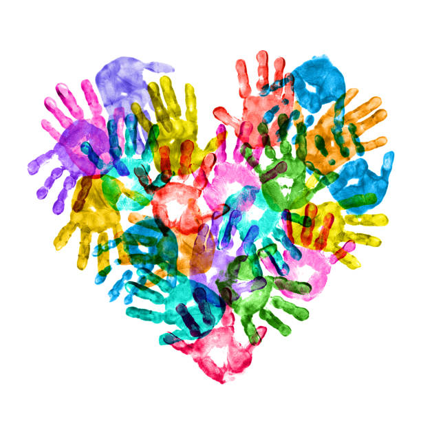 Colorful Children Hand Prints Forming a Heart Shape stock photo