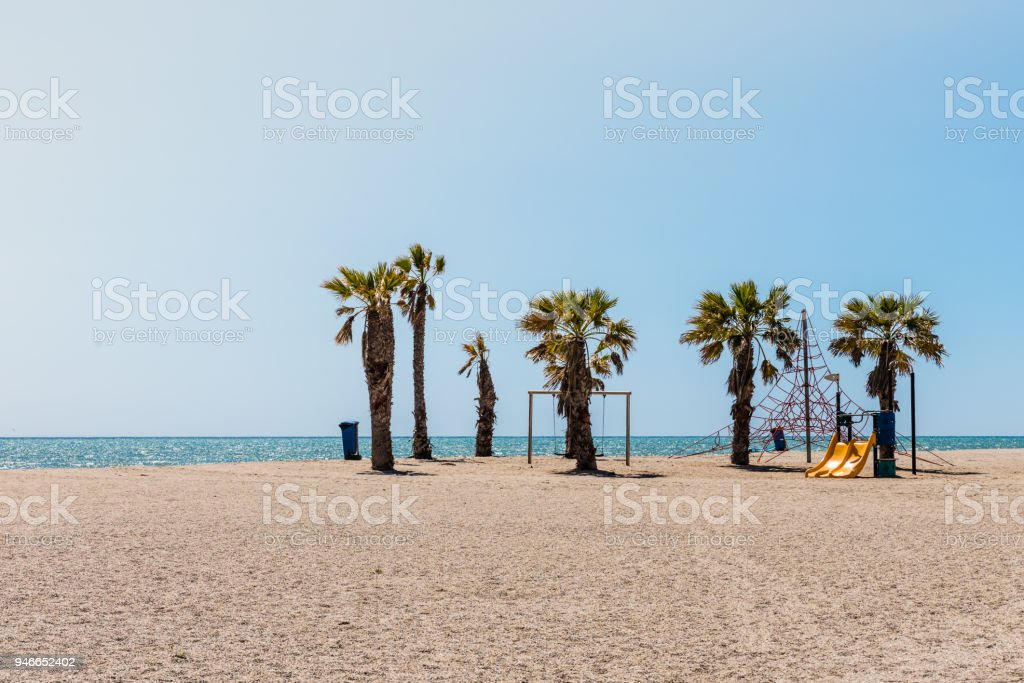 colorful children's Playground on the beach on a hot day, Playground for children near the sea, relax and fun stock photo