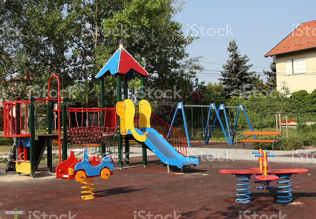 Colorful children's playground with slide and climbing frame royalty-free stock photo