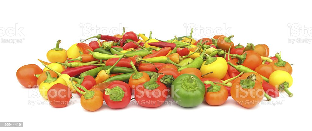 Colorful chili peppers on white royalty-free stock photo